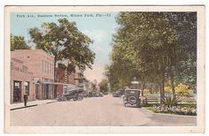 This vintage postcard of Winter Park Florida is looking south down Park Avenue.  Central Park is on the right.