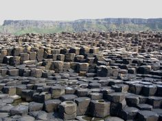 Giant's Causeway in Northern Ireland, formed by volcanic eruptions over 50 million years ago. The plates that make up the columns are clearly seen in this shot. Photo by Patrice78500 / Wikimedia Commons.
