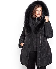 Here is a warm plus size winter coat from Ookpik that'll protect you from bad weather. Filled wiith down to protect against the cold, this jacket also has a fur-trimmed hood to protect against the wind. Asymmetrical zipper, 37 inch length.