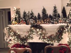Christmas village mantle display..very pretty....but then where would I put the stockings?