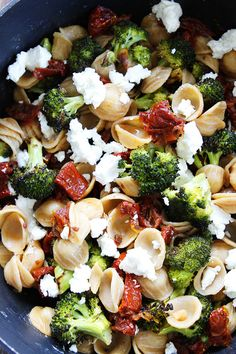 Creamy Goat Cheese Pasta with Roasted Broccoli and Sun-Dried Tomatoes Recipe on twopeasandtheirpod.com This easy pasta dish is perfect for busy weeknights!