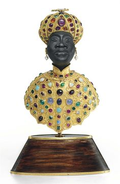 AN ITALIAN GOLD AND GEM-SET EBONY BLACKAMOOR MARK OF GIULIO NARDI, VENICE, 20TH CENTURY