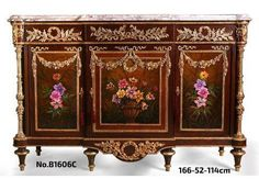 A French Louis XVI style ormolu-mounted veneer inlaid Sideboard, after the model by Martin Carlin, circa 1880 with eared breakfront moulded marble top above a frieze-drawer mounted with ribbon-tied ormolu laurel wreath, over three cupboard doors hung with floral garlands and decorated with paintings of flower and roses by our artists, all within Cyma Recta style ormolu borders, the fluted ormolu chinoises columnar angle supports over a shaped frieze, on six toupie feet