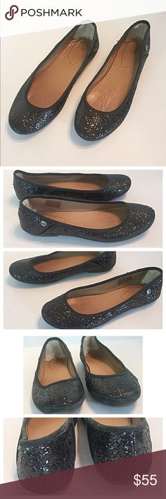 """Ugg Black Antora Glitter Flats Super stylish and flats by Ugg Australia. The shearling lined heels are very comfortable! Logo rivet on outside of each shoe. Leather footbed and rubber outsole. Heels are a mere 1/4"""". Measures: length 10"""", width 4"""". UGG Shoes Flats & Loafers"""