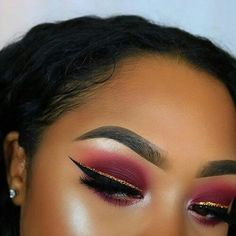 Crimson red shadow  with  glitter  liner and black winged liner. Makeup idea for prom.