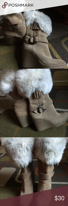 "Marc Fisher boots🌸 Style is Dobbs🌸 tan suede boots with faux fur tops🌸boot is a wedge style🌸 heel is approx 3.5"" 🌸 tassel and buckle accents on sides🌸 boot measures approx 13"" from bottom to top🌸 Marc Fisher Shoes Wedges"