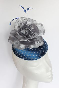 Dark Blue base with silver netting, silver rose and blue feather detailing. Small hat perfect for a wedding guest or day at the races. Blue Feather, Race Day, Silver Roses, Dark Blue, Base, Button, Wedding, Valentines Day Weddings, Deep Blue