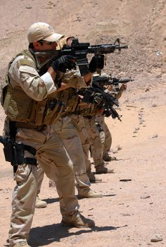 MIDDLE EAST (July 5, 2009) U.S. Navy explosive ordnance disposal technicians demonstrate a course of combat marksmanship using the M4 service rifle as part of a course of instruction on basic combat marksmanship during operation Infinite Response 09. (U.S. Navy photo by Mass Communication Specialist 1st Class Joseph W. Pfaff/Releasd)