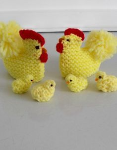 Pair of vintage knitted egg cozies with a family of little chicks, perfect for Easter