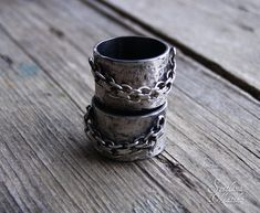 Mens wedding band. Ring with a chain in Rock style. A chain is freely hanging, fixed with soldered jump rings. So it is looks very nice. Stylish band for girls and men, unisex ring. Measurements: Wide of a ring 12mm, wide of a chain 3,5mm Material: oxidized sterling silver Ready to ship: Size: 5.5 (16mm) I will glad to make a ring special for your size. Please choose your size from the drop down size selection or contact me if you need individual size. Production time is about 4-5 days. I…