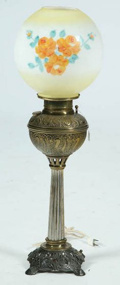 lighting, America, An unattributed banquet lamp, yellow and white ball shade with hand-painted flowers. The base has an embossed font, a ribbed pedestal and a pierced cast iron footed base. Circa 1876-1925