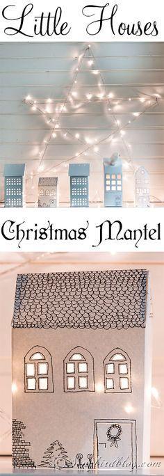 Paper houses Christmas mantel with a light star. Via http://www.songbirdblog.com