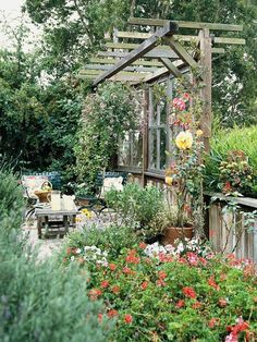 pergola with windows.  The fence at the bottom act as taking and then hang windows on neighboring sides to hide hot tub