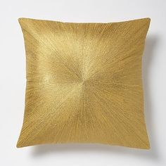 this pillow is essential as it ties in with the desk lamp in brass and the marble shelves that would go above the tv