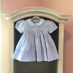 Feltman Brothers Pintucked and Smocked Dress and bloomer, is a soft sweet and timeless dress for your little girl! It has a peter pan collar, French lace trim, puffed sleeves and gorgeous diamond smocking with floral bullions! You will love this dress on your princess! Available in blue or pink in sizes 3m, 6m, & 9m!  http://www.feltmanbrothers.com/pintucked-and-smocked-dress-and-panty/