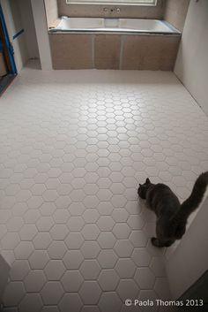 Large hexagonal tiles for bathroom floor.