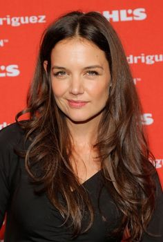 Popular center parting layered long wavy hair style for women Here is Katie Holmes' latest hairstyle, she sports a smart and classy look with this long wavy cut. Long layers have been added throughout the lengths of the hair complemented beautifully with soft flowing waves. The hair is parted in the center and given a[Read the Rest]