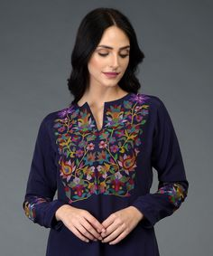 Talking Threads Signature suits are crafted in fine fabrics and adorned with exquisite embroideries. This Eclipse Blue long tunic k Embroidery On Kurtis, Hand Embroidery Dress, Kurti Embroidery Design, Embroidery On Clothes, Embroidered Clothes, Embroidered Tunic, Embroidery Patterns, Kurta Designs Women, Kurti Neck Designs