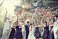 Throw leaves at the bride and groom at a fall wedding as they leave