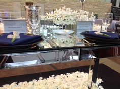 Formal Modern Classic // Modern wedding reception with white petals and white orchids in the centerpieces