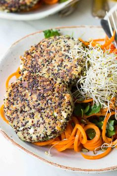 Quinoa Patties with Feta and Parsley, served on a bed of spiralized carrots! Vegetarian and Gluten free! Get the recipe at nutritionistmeetschef.com