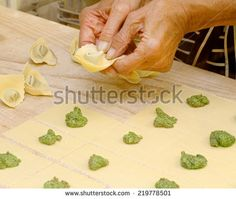 hands creating home made ravioli - stock photo