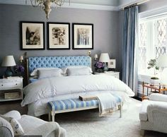Beautiful serene bedroom.  Like the detail of long slim pillows in front of double stacked pillow. Love the curtains.