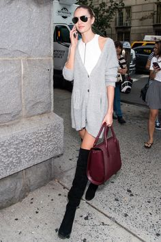 Candice Swanepoel The Lesson: It's all about an oversized cardigan and over-the-knee boots.