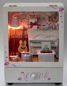 Skříňka - hudební pokoj Země Miniatur