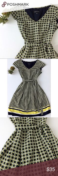 """Jones New York Dress Perfect dress for the office!  Pretty  navy blue, white and yellow checkered print with bold stripes at the hemline.  Flattering belted A-line silhouette. Soft box pleats at waistline below belt.  Knee-length (about 38"""" in length). V-neck.  Short cap sleeves.  Pull on, side zipper & hook closure.  Please see photos for measurements. Light and flowy -- perfect Everyday Dress!! Jones New York Dresses"""