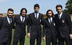 Italian soccer team wears custom three-piece Dolce & Gabbana Martini Suits.