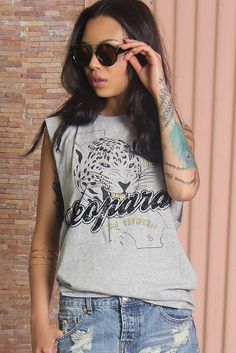 Grey printed cotton tank by Somedays Lovin, featuring a high ribbed scoop neckline, a sleeveless design with raw edges and a vintage-style washed effect. Oversize leopard face graphic on the front.