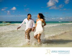 Jorge Rodriguez Photography - Destination Wedding Photography & Portrait based in Playa del Carmen, covering Tulum, Cozumel, Isla Mujeres, Cancun & Riviera Maya Mexico  - Engagement Portraits Tulum: Rani & Travis stayed at Grand Palladium Colonial but they decided to book the transportation service for an additional fee and explore Tulum during the sunrise, we had a great fun stopping the morning rush hour on the road and climbing some rocks next to the ocean..Upon request, I will be happy…