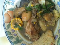 Sancocho wit coriander, plaintain, yucca, corn on the cob,potatoe and chicken wit an arepa