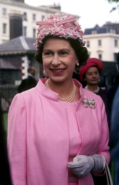 Queen Elizabeth II (then simply the Princess) it was a fruity look at the Stock Exchange in 1949      Side-by-side with sister Princess Ma...
