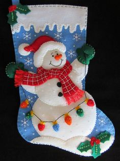 I hand cut and stitch my stockings with love and care. Each stocking takes over 40 hours to make and comes completely lined with Christmas cotton fabric. All beads and sequins are also attached by hand in a smoke free home. Christmas Stocking Decorations, Christmas Crafts To Make, Felt Christmas Ornaments, Christmas Bags, Christmas Stockings, Christmas Wreaths, Felt Doll Patterns, Diy Stockings, Snowman Quilt