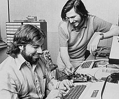 Steve Wozniak and Steve Jobs in their garage working on their early computer technologies, 1975.