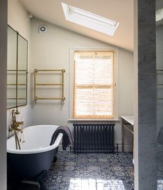 The bathroom features vintage brass taps, a mid-century brass-framed mirror and Moroccan floor tiles which are from Habibi Interiors (JAMES MERRELL). A fashionable East London home - Telegraph Ceramic Tile Floor Bathroom, Best Bathroom Tiles, Moroccan Bathroom, Bathroom Colors, Bathroom Flooring, White Bathroom, Bathroom Furniture, Mirror Bathroom, Bathroom Ideas