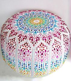 giant jewelled leather pouffe. the most beautiful pouffe i've ever laid eyes on.
