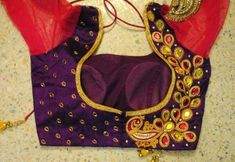A deep purple with a hot pink traditional choli pattern.