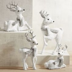When you're decorating for Christmas, don't forget to invite a few wintery woodland critters into the mix. Pier 1 has a snowy menagerie of exclusive holiday owls, foxes, penguins and this seasonal favorite—natural white reindeer—handcrafted of grass, sisal, glitter and faux fur.