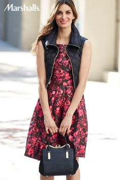 Edgy meets preppy. Pair a feminine dress with a quilted black vest. Just add a small structured bag for a night on the town.