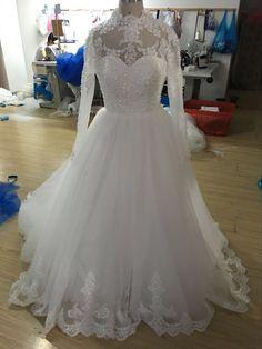 robe de mariée princesse avec manches en dentelle