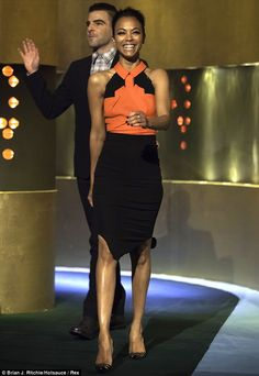 Colourful: Zoe Saldana walks on stage with her Star Trek co-star Zachary Quinto on Saturday's Jonathan Ross Show