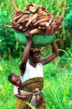 african woman carrying cassava (Manioc) - Ode to the World