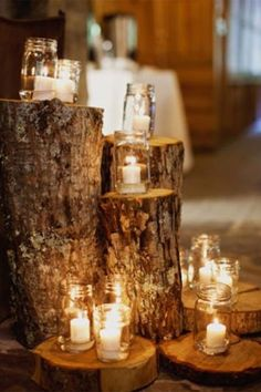 mason jar candles on tree stumps, for outside the entrance to the room, rehearsal dinner