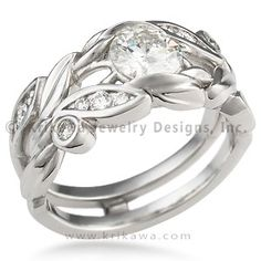 Scaffolding Garden Engagement Ring - This floral engagement ring is made to slip around a wedding band. Channel-set diamonds adorn the leaves cradling the diamond.