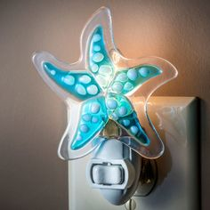 Uncharted Visions has decorative J. Devlin glass home decorations to warm up any space. This glass night light with starfish will brighten up any room.