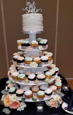 Calumet Bakery Wedding Cupcake Display with fresh flowers