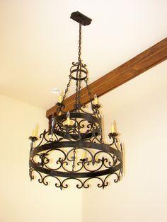 Custom hand forged iron chandelier from www.haciendalights.com